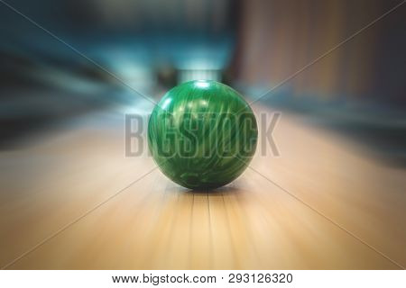 Green Bowling Ball On An Bowling Alley Background.
