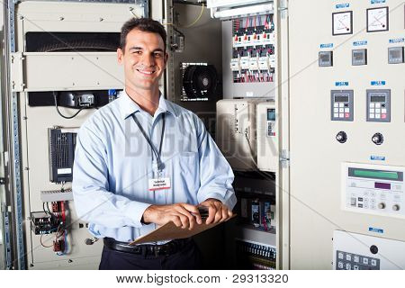 portrait of industrial engineer in front of computerized machinery