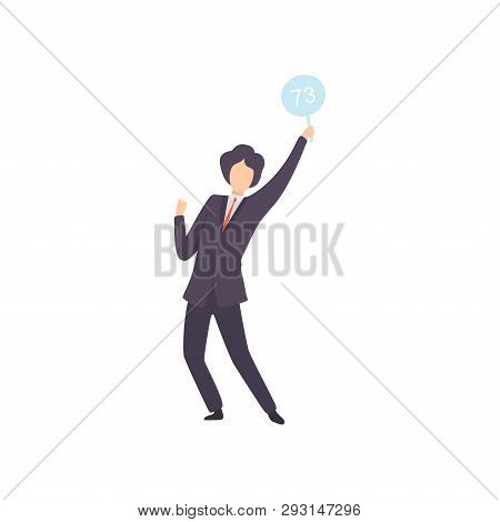 Businessman Bidding In Public Auction House, Male Bidder Standing And Rising Raising Auction Paddle