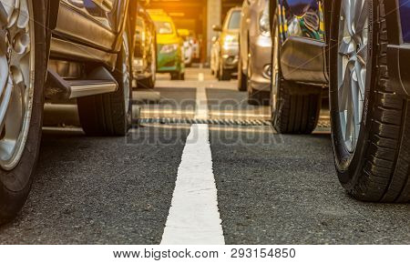 Asphalt Parking Lot Of The Airport Or Shopping Mall. Car Parking Area For Rent. Closeup Wheel Of Man