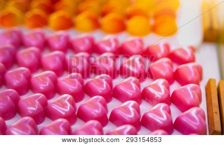 Pink Heart Shape Chocolate. Valentine's Day Gift. White Chocolate Ganache With Rose Scent On White P