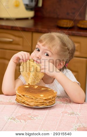 A girl with pancakes.