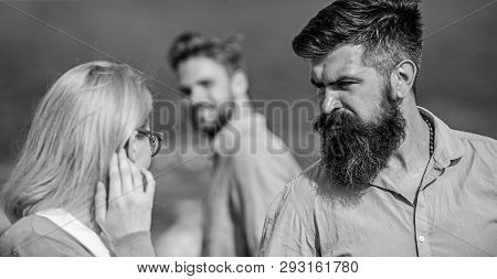 Husband Strictly Watching His Wife Looking At Another Guy While Walk. Passerby Smiling To Lady. Jeal