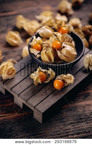 Physalis peruviana or cape gooseberry, goldenberry, poha, and physalis with calyx, exotic exported fruit poster