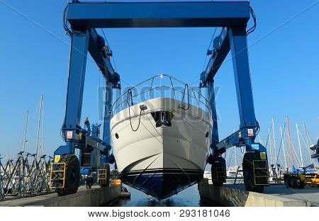 Luxury Motor Yacht Lifted By A Special Crane For The Annual Repair, Painting And Inspection. Transpo
