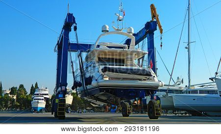 Luxury Large Yacht Transported On A Special Crane For The Annual Repair, Painting The Bottom And Che