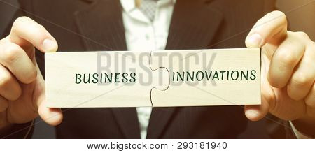 Businessman Collects Puzzles With The Words Business And Innovations. Innovative Ideas For Small Bus
