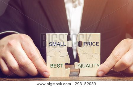 A Businessman Collects Wooden Puzzles With The Words Small Price - Best Quality. The Concept Of Prof