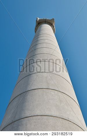 Big, strong stone columns on the street in Barcelona in Spain from bottom view, hill Montjuic. poster