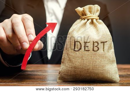 A Bag With The Word Debt And An Up Arrow In The Hands Of A Businessman. Receivables. The Growth Of D