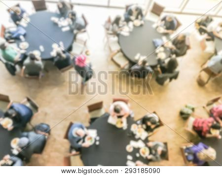 Blurry Background Crowded People At Round Banquet Table In Business Event, Top View
