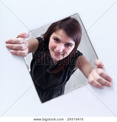 Teenager Crawling And Peeking Out Of A Hole
