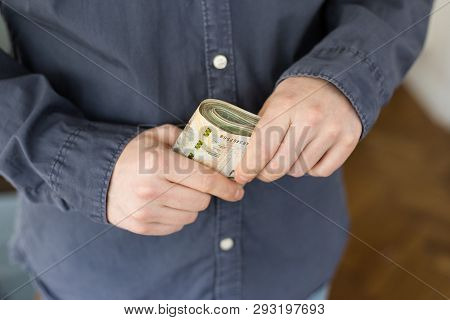 Confused Man With A Bundle Of Polish Money In His Hand