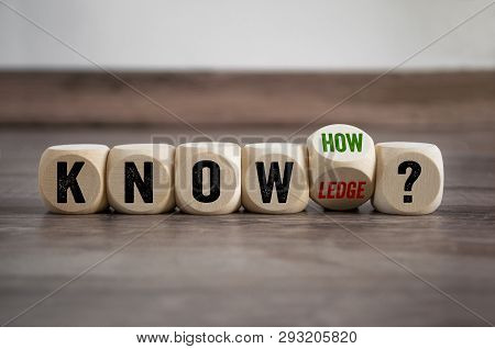 Cubes Dice With Knowledge And Knowhow On Wooden Background