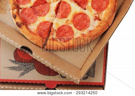 Pepperoni Pizza In Delivery Box Close Up Top View On White Background At Home. Traditional Classic I
