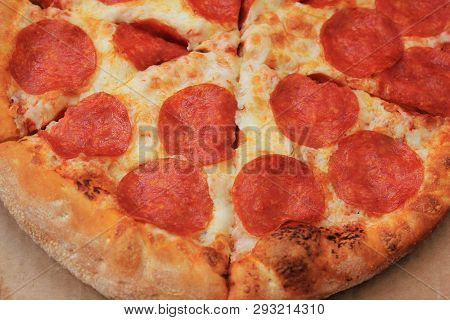 Pepperoni Pizza Slices Isolated On Wooden Board Close Up View. Traditional Classic Italian Pizza Wit