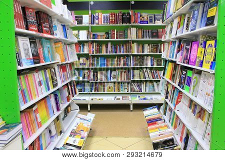 St. Petersburg, Russia - March 31, 2019: Bookstore Shelves With Many Books In Row. Interior Of Moder