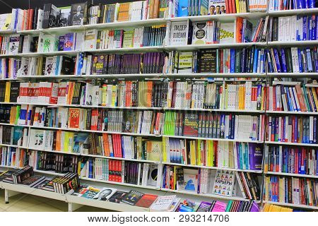 Bookshelf With Various Books And Education Materials Standing In Row At Modern Book Store In St. Pet