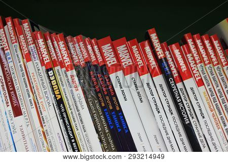 St. Petersburg, Russia - March 31, 2019: Marvel Comic Books Hardback Stacks In Row On Shelf Close Up