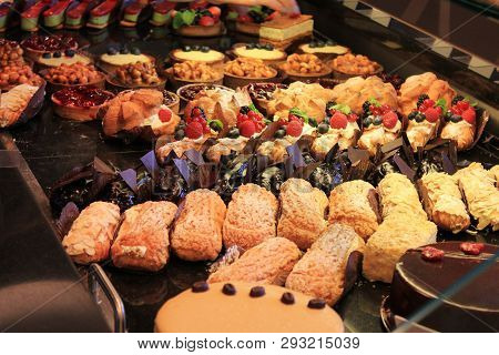 Bakery Products Desserts, Pastries, Cakes And Various Sweets At Cafeteria And Coffee Shop Window. Ma