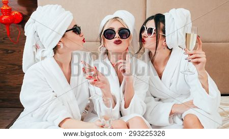 Celebration Party At Spa. Friends Congratulation. Young Women With Champagne. Sunglasses, Bathrobes