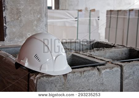Construction Helmet Close-up On A Construction Site. Construction Helmet As Protection While Working