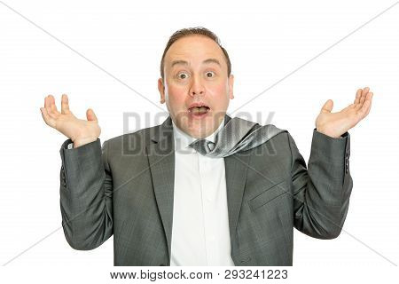 A Portrait Of A Funny, Surprised Business Man In Suit Shrugging With A White Background And Copy Spa