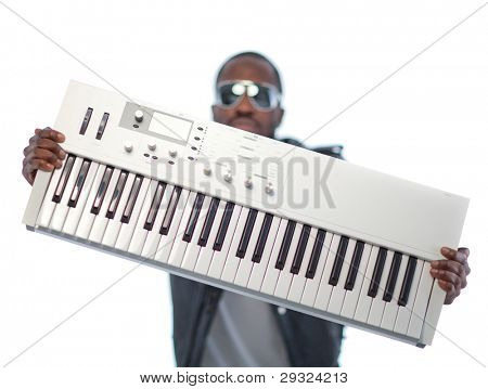 Young black man with headphones and a keyboard. Isolated over white.