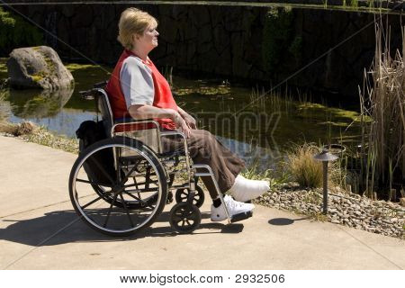 Woman In Wheel Chair At Park