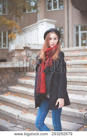 beautiful girl on the background of the old building. portrait. Makeup and Hairstyle