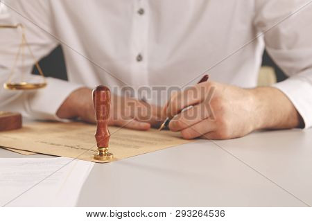 Male Lawyer Working With Contract Papers And Wooden Gavel On Tabel In Courtroom. Justice And Law , A