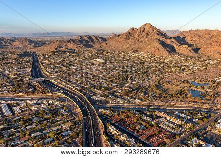 Sun Setting On Piestewa Peak And The Piestewa Peak Parkway (arizona State Rout 51) In Phoenix, Aeria