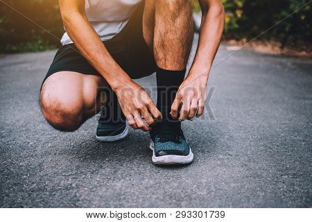 Runners Tied In Shoes,man Run On The Street Be Running For Exercise,run Sports Background And Closeu