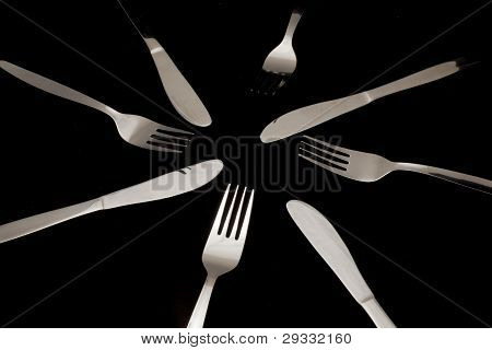 Forks, Knives And Spoons On A Black Background