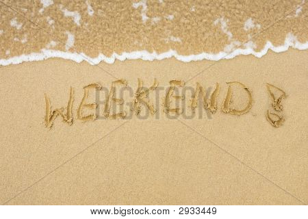 Sandy Beach With Word Weekend Written On Sand