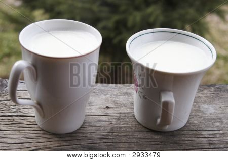 Two White Cups Of Milk