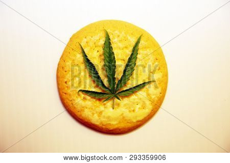 Marijuana. Cannabis. Cannabis Cookie. Marijuana Cookie. Isolated on white. Room for text. lemon cookie with marijuana leaf. Edibles. Cooking with Cannabis. Desert.  Medical Marijuana.