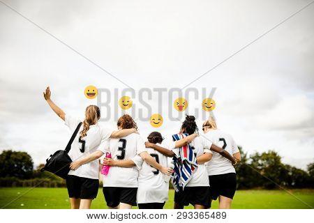 Cheerful female football players huddling
