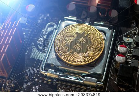 Golden bitcoin lying on the electronic computer component. Business concept of digital cryptocurrency. Blockchain technology, bitcoin mining concept,closeup of bitcoin