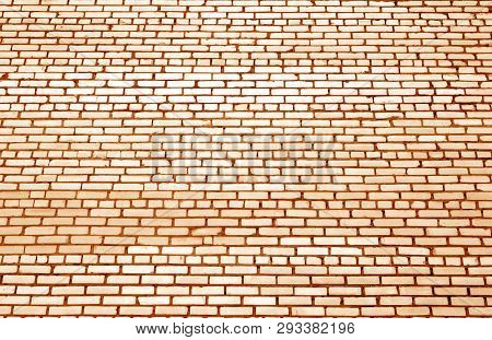 Pattern Of Brick Wall With Blur Effect In Orange Tone. Abstract Architectural Background And Texture