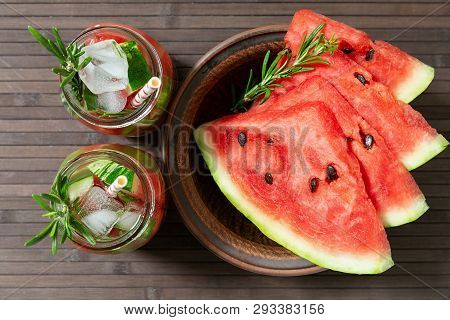 Refreshing Summer Watermelon Drink With Rosemary, Watermelon Slices  On A Plate. Watermelon And Rose