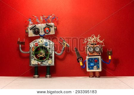 Repair Service Concept. Robots With Handyman Diy Tools. Two Funny Robotic Characters With Pliers And