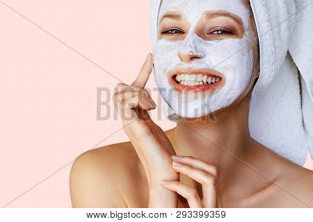 Beautiful Young Woman Applying Facial Mask On Her Face. Skin Care And Treatment, Spa, Natural Beauty