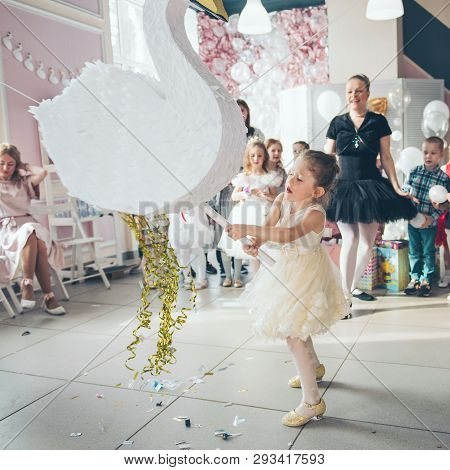 Perm/russia - March, 31, 2019: Little Girl Is Going To Broke The Pinata. Children Birthday Party.