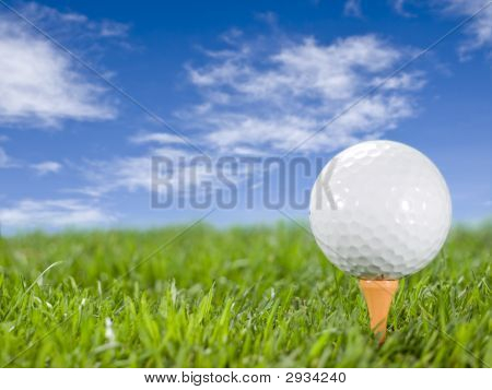 Golfball On The Grass.