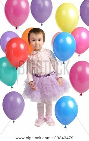 Little baby with many colorful balloons against white