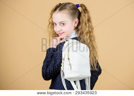 Schoolgirl ponytails hairstyle with small backpack. Carrying things in backpack. Learn how fit backpack correctly. Girl little fashionable cutie carry backpack. Popular useful fashion accessory poster