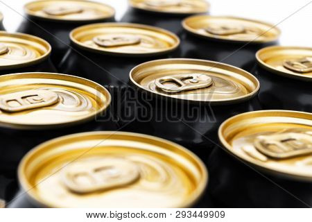Close Up Photo Of Aluminium Cans In A Raw. Aluminium Can Background. Can Pattern. Aluminium Beverage