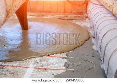 Pouring Concrete Screed On Electrical Heating Cable For Installing Comfortable And Adjustable Warm F