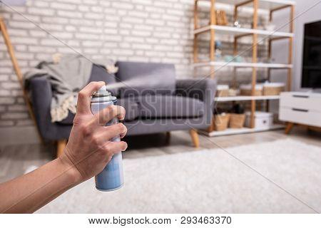 Human Spraying Air Freshener